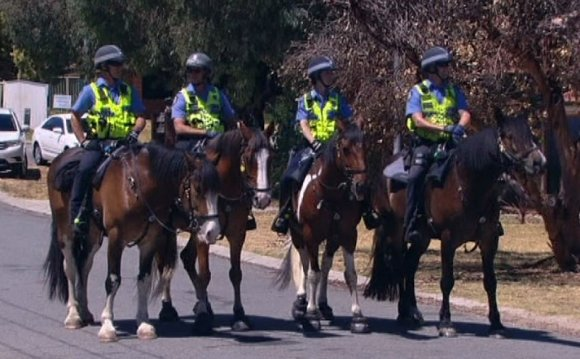 WA Police on horses patrol a