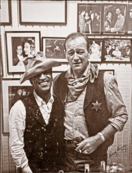 Filmed during the Civil Rights movement, Sergeants 3 became a significant Western for that era because Sammy Davis Jr. was cast as a comic equal...wearing John Wayne's iconic cavalry hat nonetheless! Heritage Auctions sold this photo of the two friends at its John Wayne auction in 2011.– Courtesy Heritage Auctions –