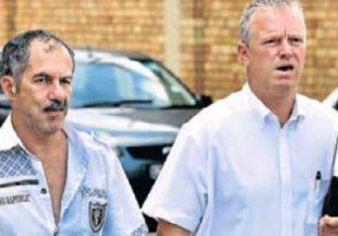 Martin Stevens, left, arrives at Mount Road police station with his attorney Dean Murray. Picture: MIKE HOLMES