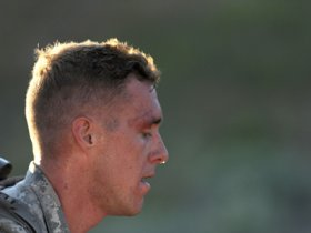 Specialist Cruser Barnes of the Hawaii Guard takes a short breather during the ruck march event of the 2015 National Guard Best Warrior Competition at Camp Williams, UT. Barnes was named Guard Soldier of the Year. —Photo by SFC Jon Soucy