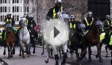 Mounted police charge tuition fees protesters
